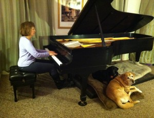 Lisa playing piano for dogs